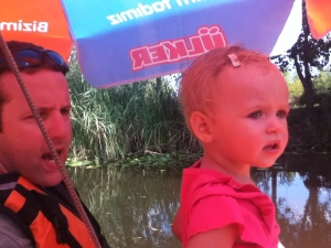 "We took a trip through a pond on a paddle boat. Here is Scott being a typical dad guide...""now Ellie, if you look of yonder in the East you'll spot...."""
