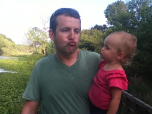 Scott is teaching Ellie about a proper duck face so she'll be ready for facebook someday.
